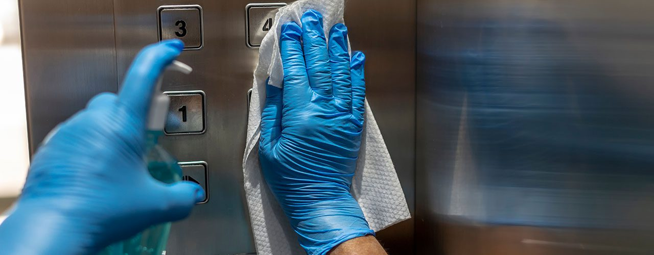 Cleaning Elevator with Gloves