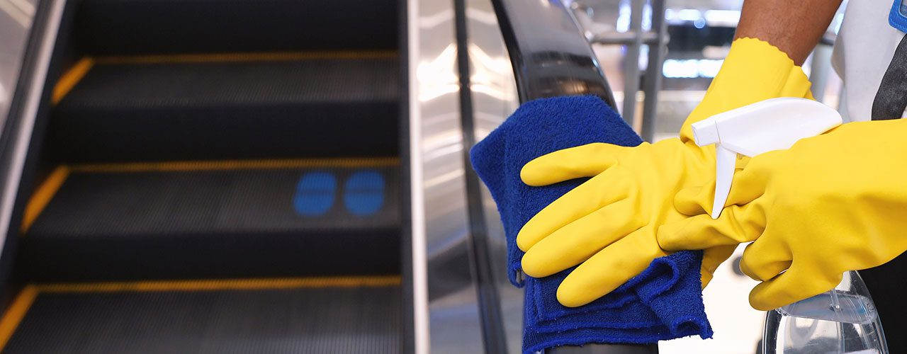 Man With Gloves Cleaning Rail